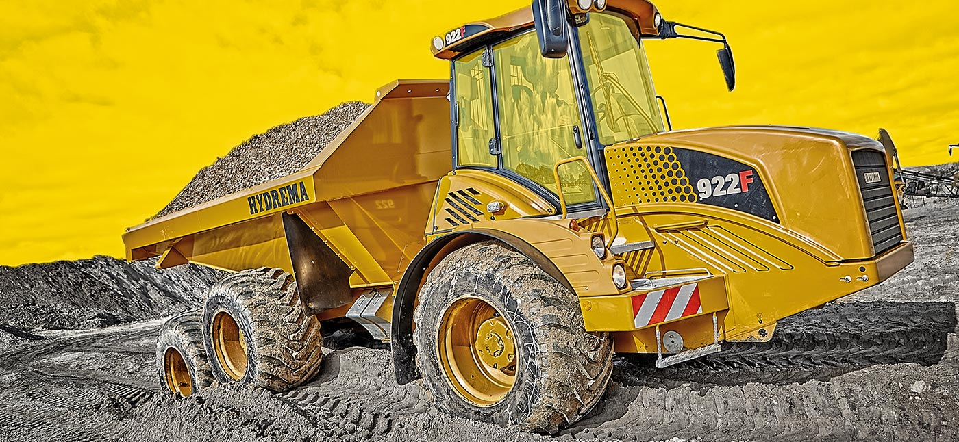 Hydrema 922HM F-Series dump truck moving gravel in rough terrain